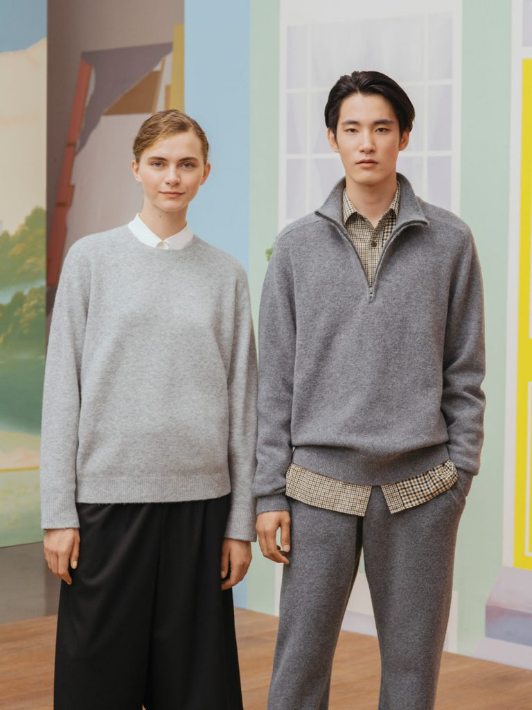 Man and woman pose in grey outfits
